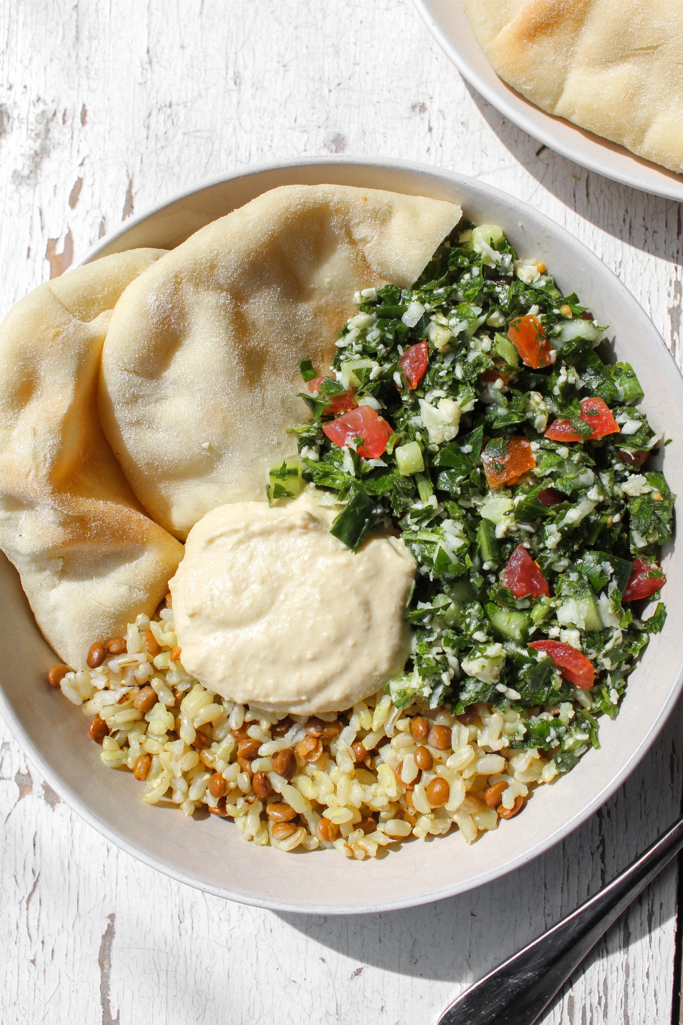 Cauliflower Tabbouleh Salad with Lentil Rice, Pita and Hummus.
